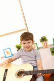 Happy five year old with guitar stock photo