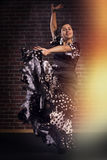 Happy flamenco dancer in motion with beautiful dress Royalty Free Stock Photo