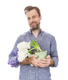 Happy florist caucasian man holding pots with flowers Stock Photography