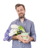 Happy florist caucasian man holding pots with flowers Stock Images