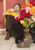 Happy florist resting after hard work stock photos