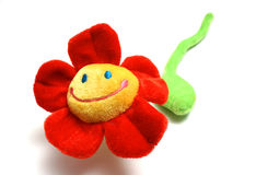 Happy flower. A red plushy happy flower royalty free stock photography