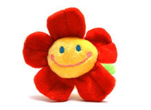 Happy flower. A red plushy Happy flower royalty free stock photos