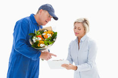 Happy flower delivery man with customer Royalty Free Stock Images