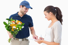 Happy flower delivery man with customer Royalty Free Stock Photos