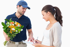 Happy flower delivery man with customer Stock Photography