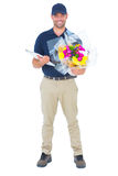 Happy flower delivery man holding clipboard Royalty Free Stock Image