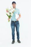 Happy flower delivery man holding clipboard Stock Photos