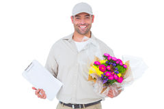 Happy flower delivery man holding clipboard Royalty Free Stock Images