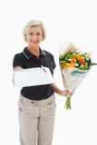 Happy flower delivery woman looking for signature Royalty Free Stock Photography