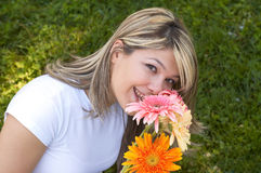 Happy with flowers stock photography