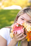 Happy with flowers Stock Images