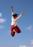 Happy flying girl. Girl jumping high off the dunes in Maspalomas in Gran Canaria stock photo