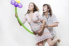 Happy flying pregnant couple Royalty Free Stock Image