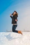 Happy flying in winter snow time by young woman. Outdoor Stock Photo