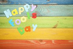 Happy Fools Day. Inscription Happy Fools Day on wooden table royalty free stock photography
