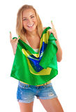 Happy football fan. Beautiful blond girl holding in hands Brazilian national flag isolated on white background, world cup concept Stock Photo