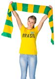 Happy football fan in brasil tshirt Royalty Free Stock Photo