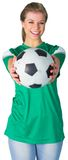 Happy football fan in green Royalty Free Stock Image