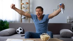 Happy football fan loudly congratulating team on winning tournament, match on tv. Stock photo Royalty Free Stock Images