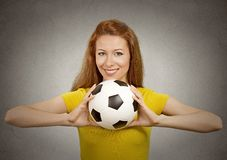 Happy football girl in yellow t-shirt. Portrait happy football girl in yellow t-shirt on grey wall background. Positive face expression, emotion, feeling Royalty Free Stock Photos