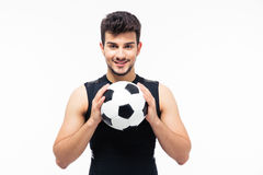 Happy football player holding soccer ball Stock Photos