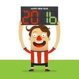 Happy football player holding substitution board with Happy New Year 2016 massage. Stock Photos