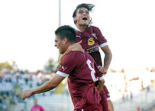 Happy football players celebrate a goal Stock Images
