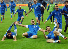 Happy football players celebrate qualifying to FIFA World Cup 2014 Stock Image