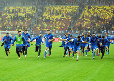 Happy football players celebrate qualifying to FIFA World Cup 2014 Stock Images
