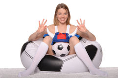 Happy football and soccer fans in an armchair Stock Image