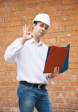 Happy foreman with documents Royalty Free Stock Images