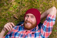 Happy forester on vacation in forest, man in hat. With beard Royalty Free Stock Photos