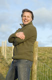 Happy forties man. A happy handsome forties man is taking a break during a a walk in the countryside Stock Photos