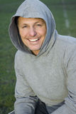 Happy forties man. A handsome forties man is laughing while he wears a hooded sweatshirt Royalty Free Stock Photo