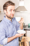 Happy forty years old caucasian man drinking coffee in the kitch Stock Image