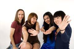 Happy four friends Stock Photos