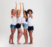 Happy four girls pointing fingers at camera Royalty Free Stock Image