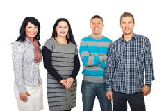 Happy four people in a row. Happy group of four people standing in a row isolated on white background stock images