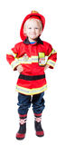 A happy four-year boy in the costume of fireman Stock Photography