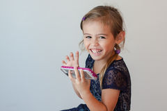 Happy four year old girl holding smart phone Stock Images