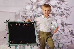 A child with Christmas presents and Christmas tree. stock photos