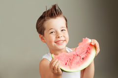 Happy four years old boy smiling with watermelon Stock Photos