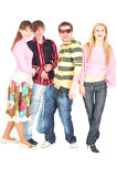 Happy four young adult friends Stock Photos