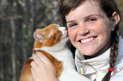 Happy freckled girl and funny red cat Stock Photo