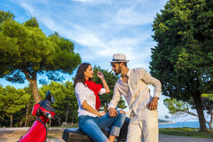 Happy free freedom couple driving scooter excited on summer holidays vacation. Young multiethnic couple Royalty Free Stock Image