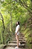 A happy free smile peace balance meditation beauty girl Asian Chinese travel hiking do yoga climb mountain bag hangzhou xihu Stock Photos