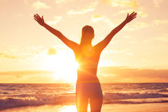 Happy Free Woman at Sunset on the Beach Stock Photos