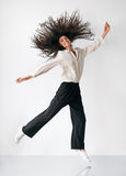 Happy freedom jumping girl. With flying hair Royalty Free Stock Photography