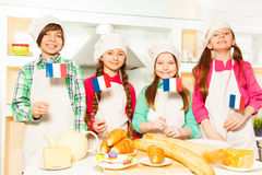 Happy French team of four young bakers Stock Image